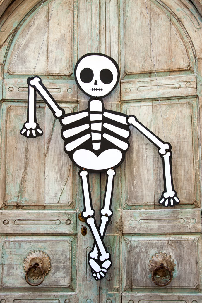 Last Minute Halloween Ideas - Printable Skeleton Door Hanging from Handmade Charlotte | Squirrelly Minds
