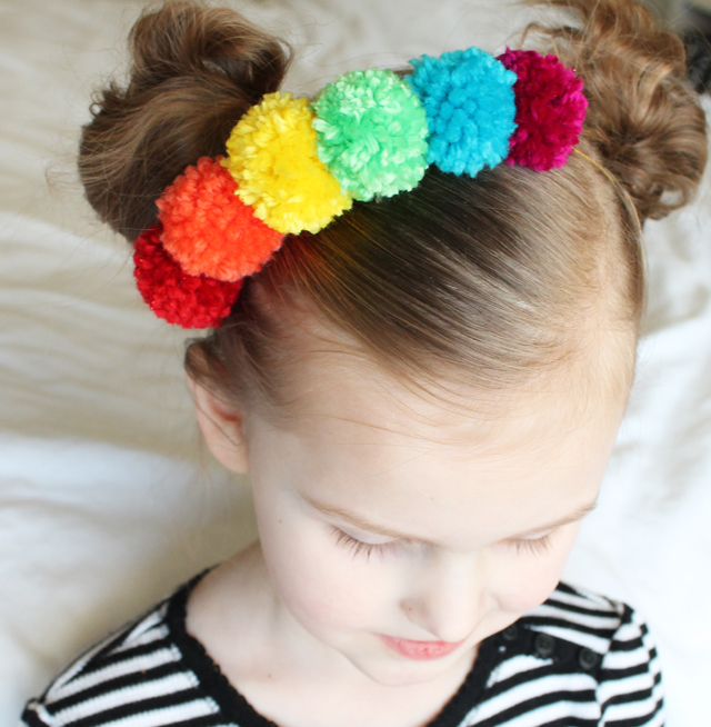 Top 10 St. Patrick's DIY's of 2015 - Rainbow pom pom necklace/headband from Sister's Suitcase